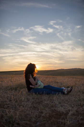 Baby Family Family Matters Family❤ Mother Mother & Daughter Mother And Son Motherhood Baby Feeding Bonding Cloud - Sky Family Bonds Family Time Family With One Child Field Full Length Hairstyle Land Side View Sitting Sky Sunset Women The Great Outdoors - 2018 EyeEm Awards