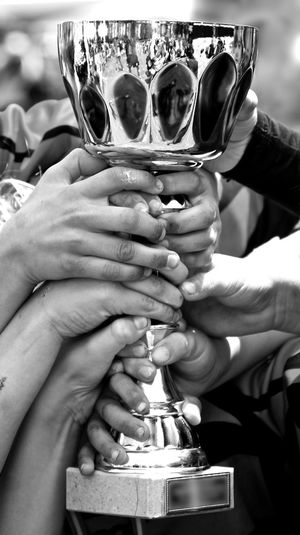 Hands Holding Athletic Trophy