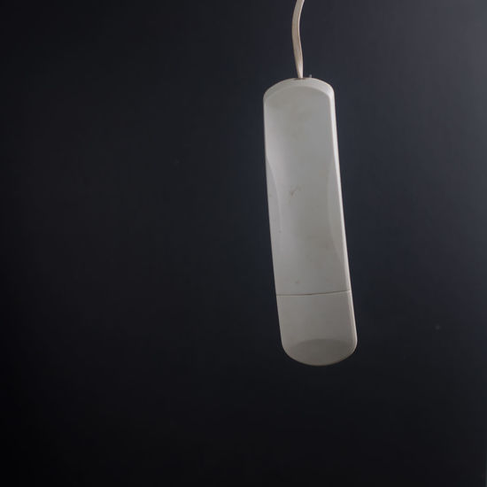 Close-up of lamp over black background