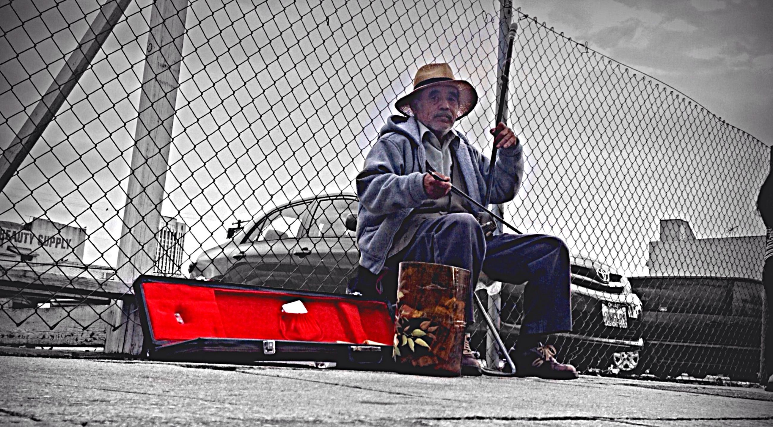 human representation, art, building exterior, built structure, art and craft, architecture, creativity, sculpture, day, outdoors, transportation, sky, statue, street, city, metal, railing, mode of transport, full length