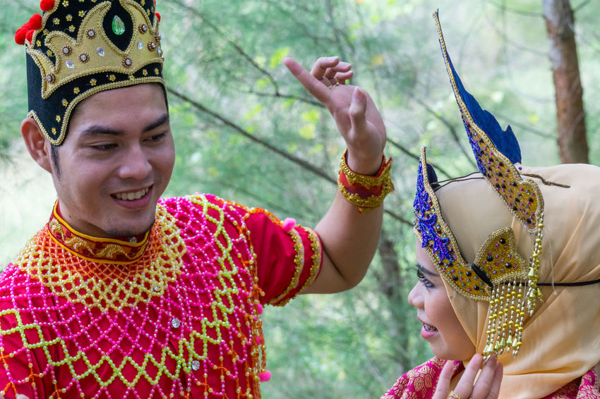 Specific to the villages of Kelantan, where the tradition originated, Mak Yong is performed mainly as entertainment or ritual purposes by couple of dancers. Adult Adults Only Celebration Childhood Day Happiness Headdress Headwear Holding Mak Yong One Person Outdoors People Real People Smiling Traditional Clothing Young Adult