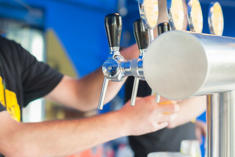 Close-Up Of Hands Working At Bar