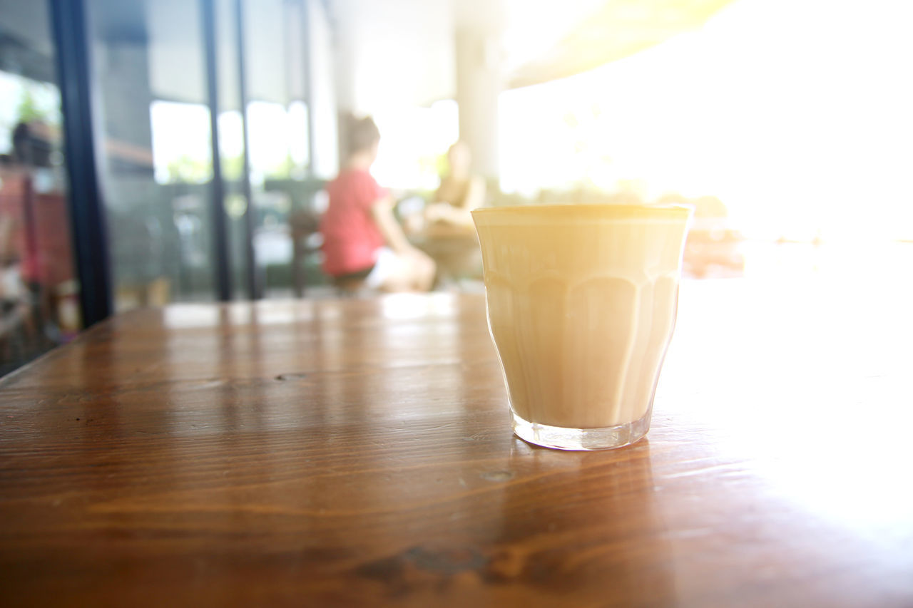 Close-Up Of Coffee Cup On Table At Restaurant