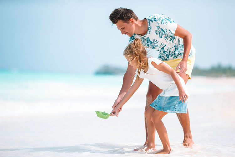 Father and daughter playing at beach