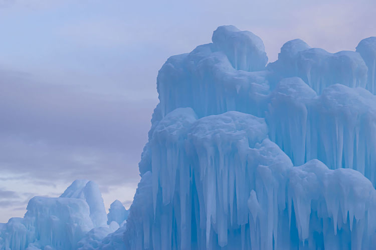 Panoramic view of snow  ice castles against sky