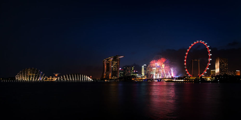 Fireworks explode above Marina Bay in Singapore. Fireworks Gardens By The Bay Marina Bay Marina Bay Sands Mbs Nature Singapore Flyer