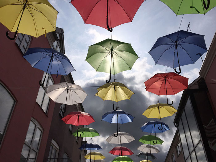 Street with colorful umbrellas against sky Beautiful Day Cityscape Colors Colourful Denmark Look Up And Thrive Sky And Clouds Sunlight Abundance Colorful Day Decoration Multi Colored My City No People Protection Sky Streetphotography Summer Sunlight And Shadow Sunshine Umbrella Umbrellas In The Sky Vejle Mix Yourself A Good Time The Week On EyeEm