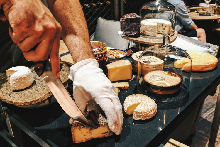 Selection of cheeses on a cart Cart Cheese Chef Food Food And Drink Hand Human Hand Preparing Food Tray