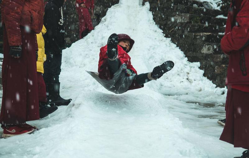 When nature gives you snowfall , make a snow slide ... Travel Tibetan  Tibet Monks Buddhism Fun Manali Himalayas Himachalpradesh Exploring Cultures Happiness Adrenaline Slide Young Adult Warm Clothing Extreme Sports Snowboarding Athlete Snow Sport Headwear Winter Adventure Sports Clothing Stunt Aerobatics Rapid Powder Snow Deep Snow
