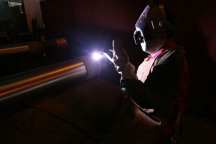 Welder welding metal in industry