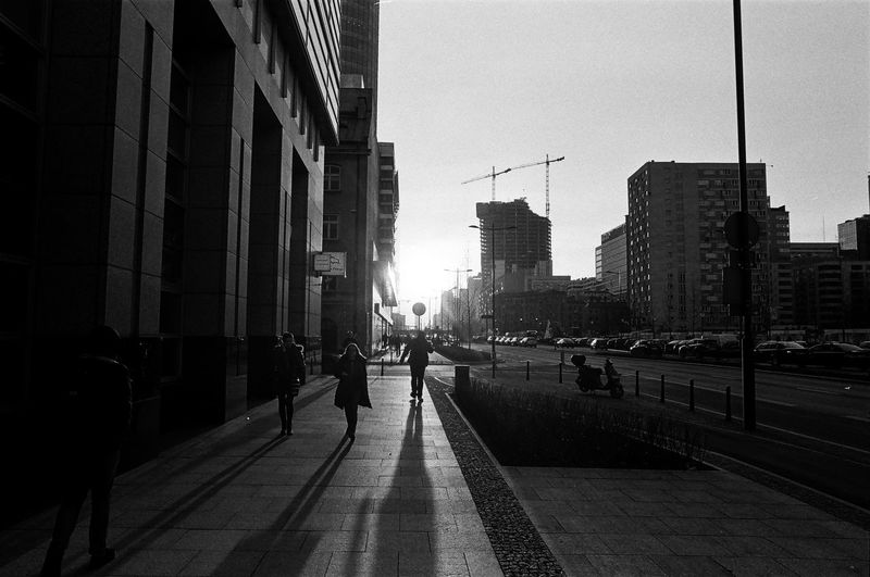 Analog; Ilford HP5 400 The Week on EyeEm Light And Shadow Capture The Moment Black And White Bnw Monochrome Film Analogue Photography Architecture Built Structure Building Exterior City Sky Building Street Nature City Life Transportation Direction Incidental People The Way Forward Office Building Exterior Day Sunlight Outdoors Cityscape Mode Of Transportation Tall - High Skyscraper