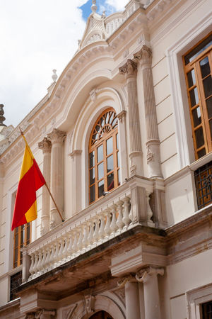 Facade of a white classic building with the flag of Bogota . Architectural Column Architecture Architecture Balcony Bogotá Building Exterior Built Structure Classic Colombia Colonial Day Daylight Façade Flag Flags Low Angle View No People Outdoors Public Building Sky South America Travel White