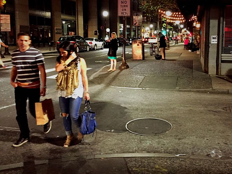 The Street Photographer - 2016 EyeEm Awards Cities At Night Couple Walking Sidewalk Warm Evening City Lights At Night Manhole  Crosswalk Showcase April Telling Stories Differently Walking Across The Street Trafficlight Live Love Shop Dramatic Angles