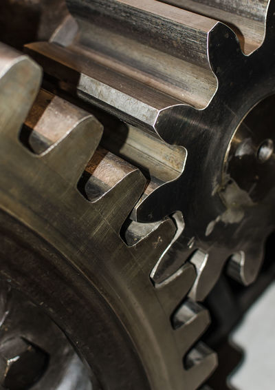 Detail of iron cogwheels Gearwheels Industry Machinery Quality Teamwork Wheel Cogwheel Concept Connection Cooperation Effectivity Engine Metal Movement Organisation Process Rotation Start Steel Strength System Technology Together Tool Transfer