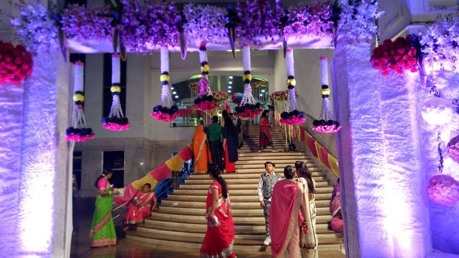 Staircase Steps Celebration Flower Steps And Staircases Built Structure People Architecture Night Illuminated Tree Indoors  Adult Adults Only Man And Women On The Staircase