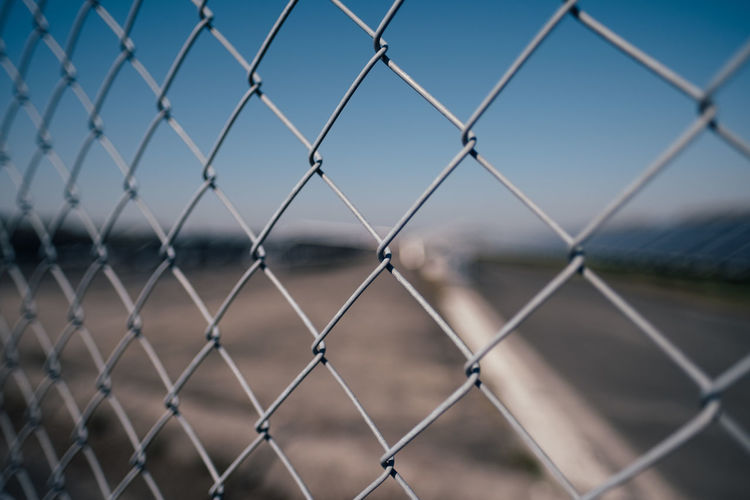 Day Nature Outdoors Sky Fence Chainlink Fence Focus On Foreground Safety Barrier Security Protection Boundary Metal Men Close-up People Real People Backgrounds Leisure Activity Full Frame