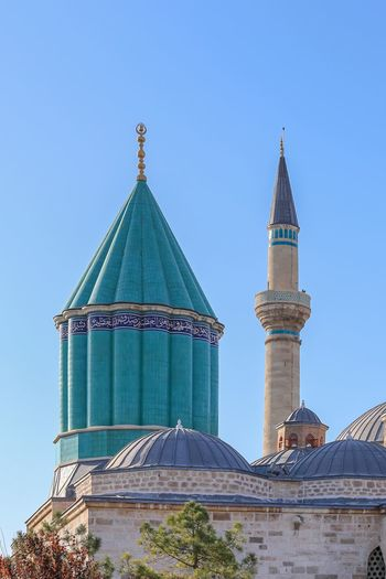 Mevlana Museum in Konya. The museum is the mausoleum of Jalal_ad-Din_Muhammad_Rumi also known as Mevlana or Rumi a Persian Sufi mystic. It was also the dervish lodge (tekke) of the Mevlevi order, better known as the whirling dervishes. It is one of the most famous Dervish lodges in the world. History Whirling Dervishes Museum Mosoleum Built Structure Architecture Building Exterior Sky Clear Sky Building Travel Destinations Religion Tower Nature Blue Low Angle View No People Travel Belief Spirituality Tourism Day Dome
