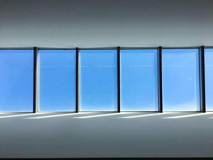 No People Architecture Built Structure Window In A Row Glass - Material Side By Side Low Angle View Indoors  Day Building Blue Geometric Shape Ceiling Window Frame Sky Design Shape