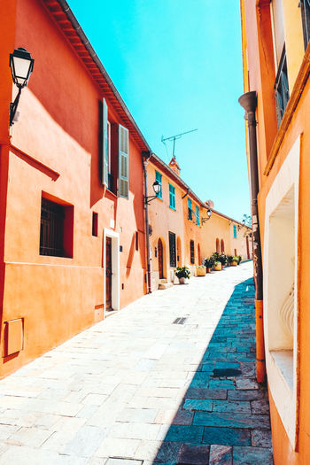 Architecture Blue Sky Building Exterior Built Structure City Day France France Streets In A Row Narrow Narrow Street No People Outdoors Pavement Sky Stone Material Streetphotography Sun Rays Sunrays The Way Forward Warm Colors