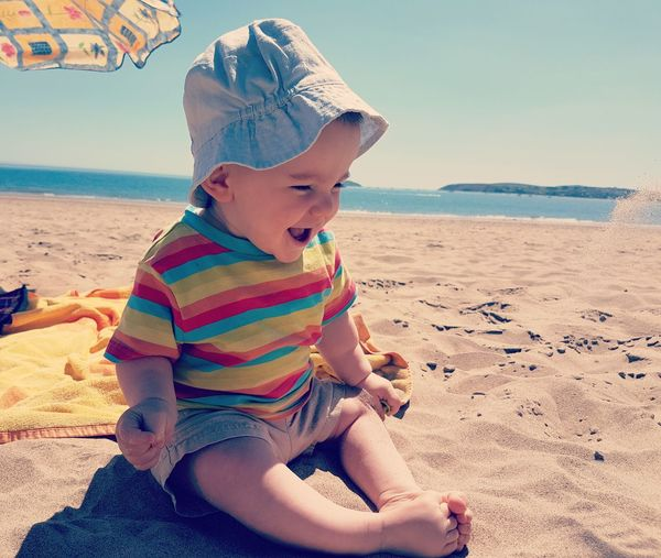 Don't Throw Sand! Playing On Beach Playing In Sand Holiday Holidays Fun Happy Sun Boy Toddler  2 Year Old Sunny Beautiful Day Sunny Day Bucket And Spade Sand Dune Water Child Sea Childhood Beach Sitting Smiling Beach Towel Coast Coastline Beach Holiday