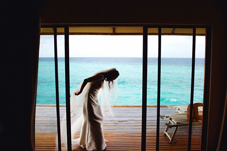 ExploreEverything EyeEm Nature Lover Wedding Dress Bride Maldives Beauty In Nature EyeEm Best Edits Women Nature EyeEm Best Shots Lifestyles Beautiful Woman Window Silhouette Silhouette_collection Ocean Ocean View Overwater Bungalow EyeEm Gallery EyeEmBestPics EyeEm Best Shots - Nature The Great Outdoors - 2018 EyeEm Awards