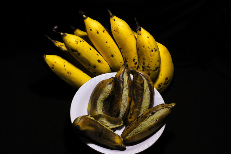 High angle view of yellow fruit against black background