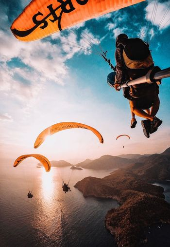 Person paragliding against sky