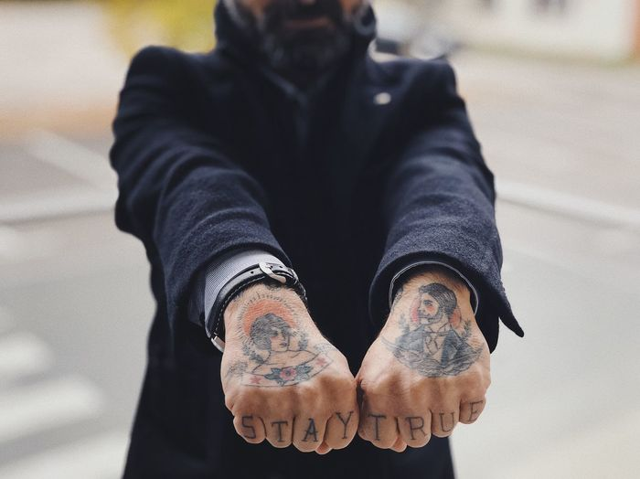 Stay true 😎... Low Section Unrecognizable Person Mobster Illegal Gangster Fist ShotOnIphone Urban Tattooed Skin Business Showing Off Bearded Beard Tattoo Real People One Person Human Body Part Lifestyles Body Part Leisure Activity Day Human Hand Hand Casual Clothing Jeans Adult Standing Clothing Close-up 17.62°