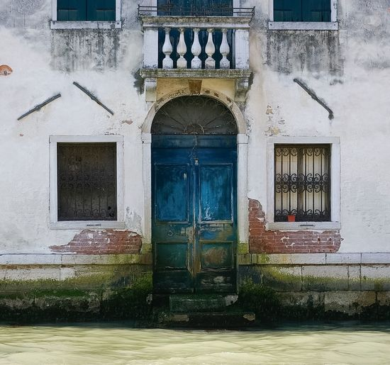 Venice doorway. Built Structure Building Exterior Architecture Door Closed Residential Building Arch Weathered Venice, Italy Canal Italy Architecture Façade