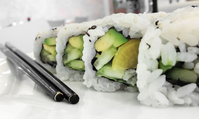 Japanese cuisine. Closeup of fresh veggie maki rolls with avocado. Appetizer ASIA Asian  Avocado Backgrounds Chopsticks Closeup Cucumber Cuisine Culture Delicacy Diet Dinner Dish Eat Food Fresh Gourmet Green Health Healthy Insideout Isolated Japan Japanese