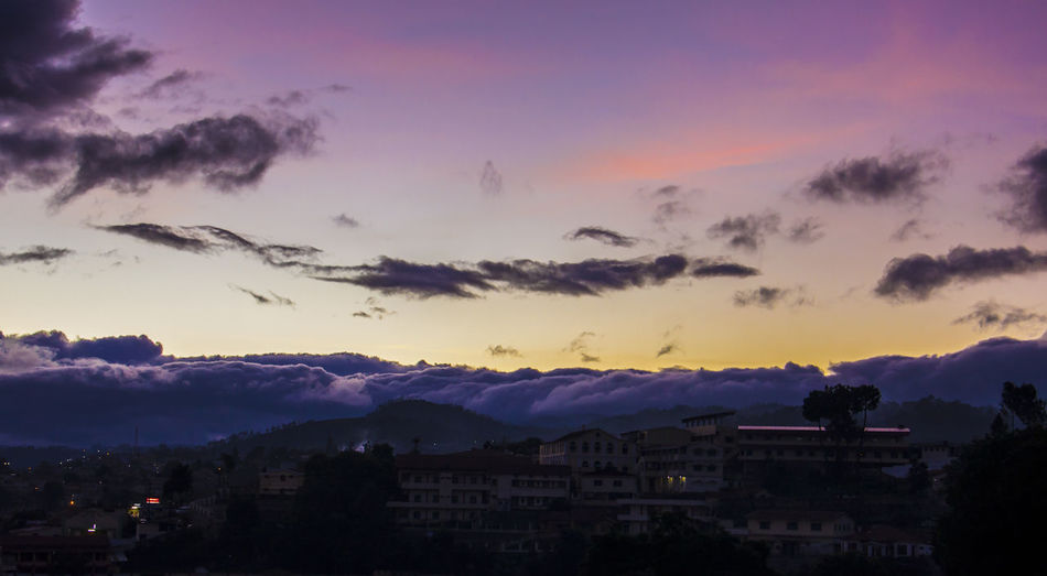 cityscape against sky at dusk Architecture Beauty In Nature City Cityscape Cloud - Sky Dusk Flying India Landscape Long Exposure Mountain Mountain Range Nature Negative Space Night No People Ooty Outdoors Science Sky Social Issues Sunset Sunset Silhouettes Travel Urban Skyline