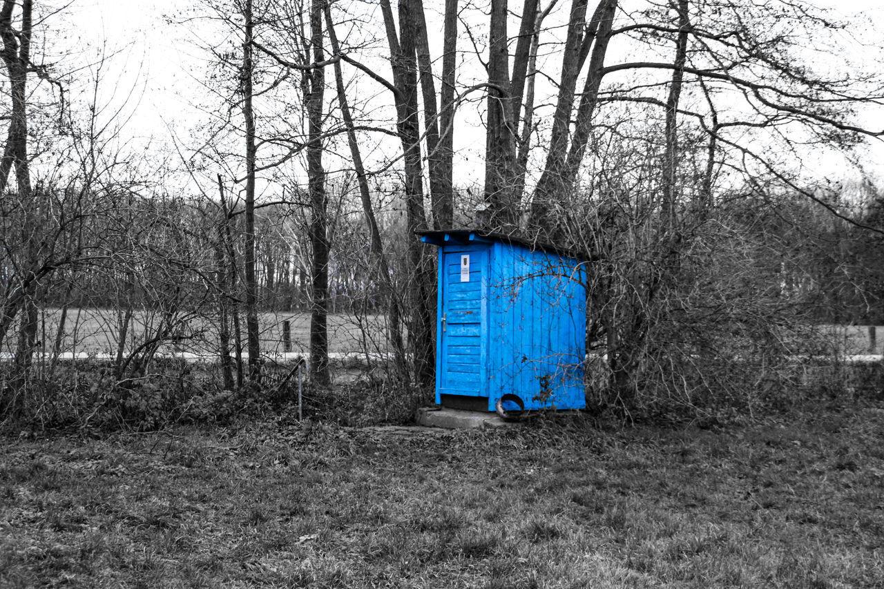 BLUE GARBAGE BIN ON FIELD
