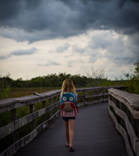 Rear View Of Girl On Walkway