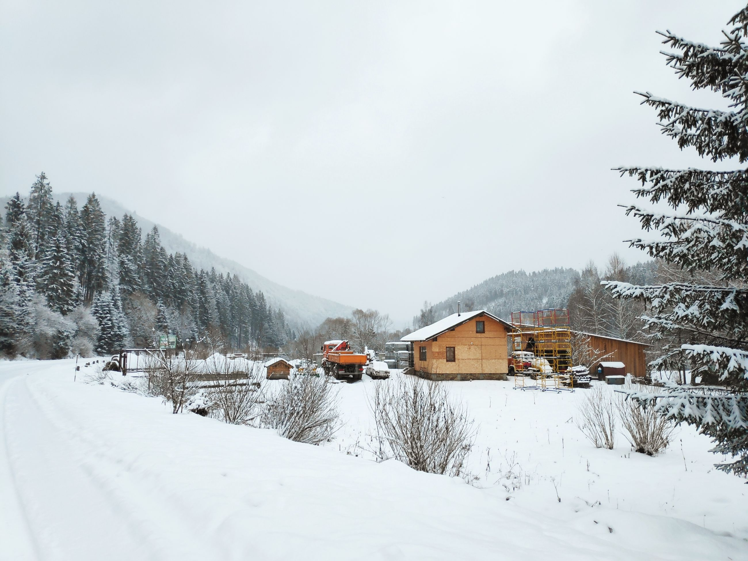 winter, cold temperature, snow, architecture, sky, tree, building exterior, built structure, nature, covering, building, house, scenics - nature, day, plant, transportation, beauty in nature, white color, no people, outdoors, snowcapped mountain, cottage