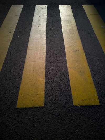 Asphalt Black Color City Crossing Crosswalk Day Dividing Line Guidance High Angle View Marking No People Road Road Marking Safety Sign Street Striped Symbol Transportation Yellow Zebra Crossing