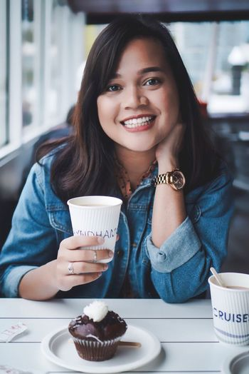 Girl drinking coffee in a cruise Smiling Looking At Camera Only Women Portrait Young Women Sitting Food And Drink Young Adult Coffee - Drink Enjoyment Toothy Smile Coffee Cup One Person Happiness Women Relaxation One Woman Only One Young Woman Only Beautiful Woman Casual Clothing