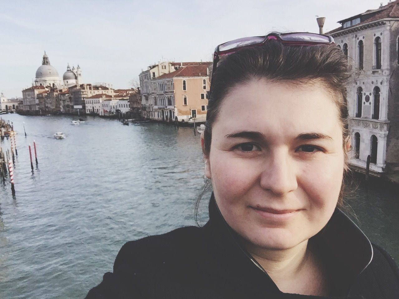 Portrait Of Mid Adult Woman Against Canal By Buildings