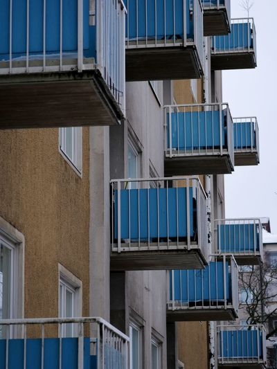 Outdoors Day Balcony Residential District Low Angle View No People City Window Building Built Structure Building Exterior Architecture Glass - Material Blue Modern Pattern Apartment Repeating Patterns Repeating Repeating Element Pattern, Texture, Shape And Form Balconies Depression - Sadness Gh5 Finland