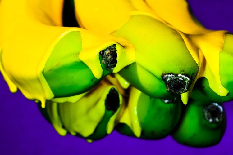 These unripe bananas needed some colour..... Yammy Banana Bananen Blue Background Close-up Creativity Fresh Fresh On Eyeem  Fruit FUJIFILM X-T2 Liquid Macro Photography Minimal Obst Pop Art Simple Photography Studio TakeoverContrast Unreif Vibrant Color Yellow