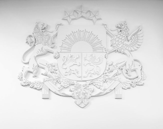 White bas-relief Coat of arms of Latvia Baltic Countries Eagle Griffin Independence Latvia National Sign Art Baltic States Bas Relief Carved Walls Close-up Coat Of Arms Decorative Decorative Art Europe Latvia Riga No People Northern Europe Republic Riga Stars Symbol White White Background