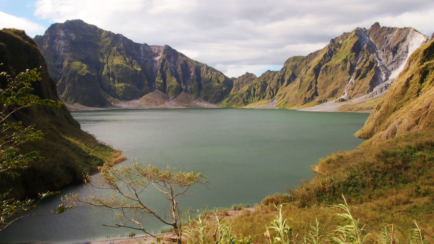Mount Pinatubo Crater Lake Philippines Travel Volcano Landscape Wanderlust Beauty In Nature Crater Day Explore Lake Landscape Mount Pinatubo Mountain Nature No People Outdoors Scenics Sky Tranquil Scene Tranquility Volcano Water