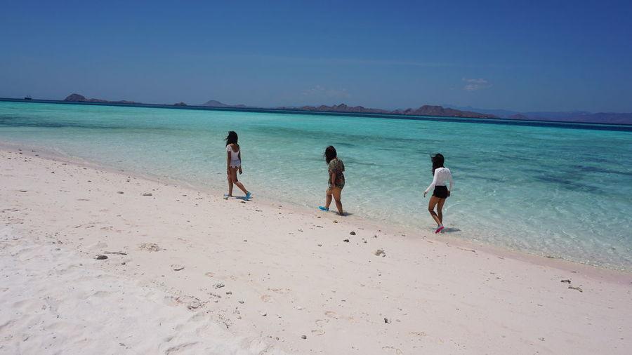 Women walking at beach