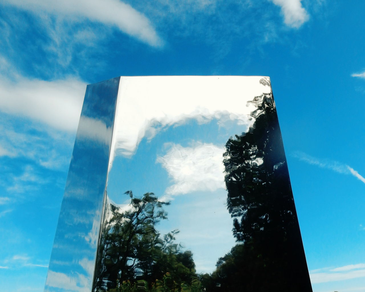 Low Angle View Of Metallic Sculpture Against Sky