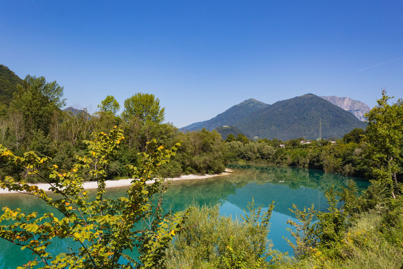 Green Slovenia Tolmin Beauty In Nature Blue Clear Sky Day Emerald Grass Growth Lake Landscape Mountain Nature No People Outdoors Peaceful Plant River Scenics Sky Tranquil Scene Tranquility Tree Water