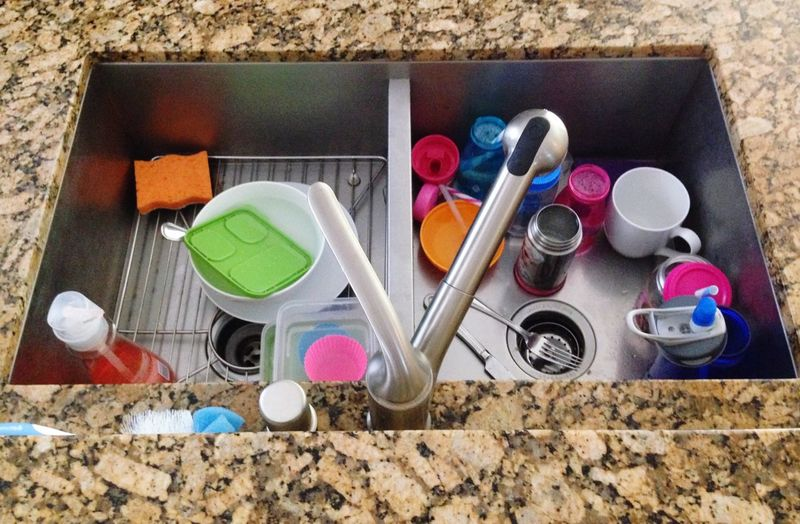 High angle view of dishes in sink