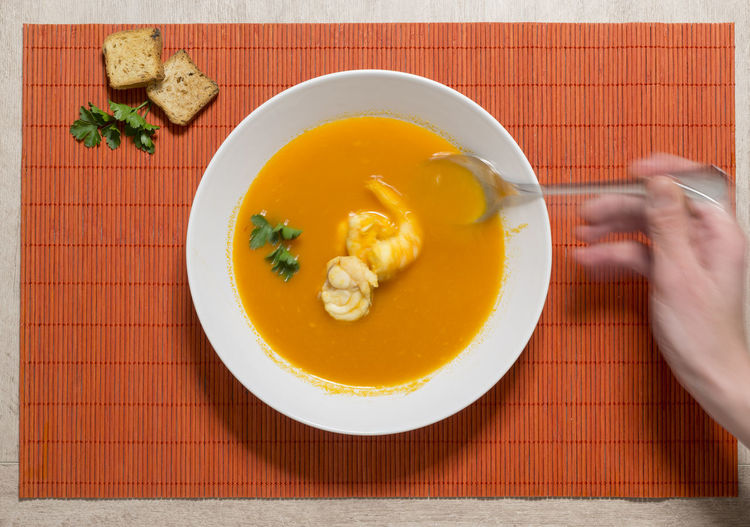 Directly above shot of hand holding soup