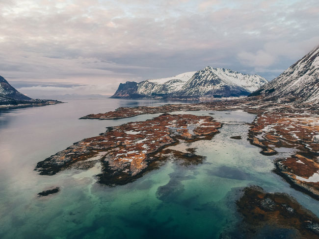 Norway Beauty In Nature Cloud - Sky Cold Temperature Idyllic Lofoten Mountain Nature No People Non-urban Scene Rock Rock - Object Scenics - Nature Sky Snow Snowcapped Mountain Tranquil Scene Tranquility Water Waterfront Winter