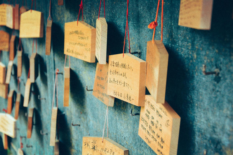 Religious offerings hanging on temple wall