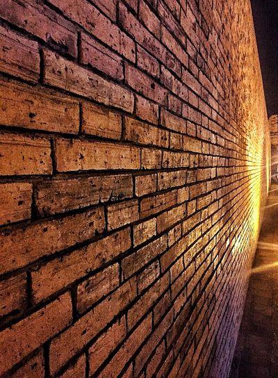 Close-up of illuminated brick wall