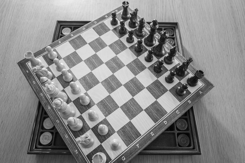 High angle view of chess pieces on board at home
